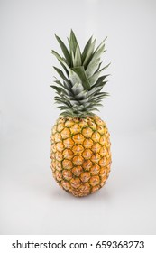 Pineapple isolated in front of white background, studio lighting