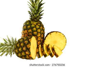 Pineapple isolated on white with pineapple slices, wet and juicy