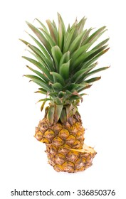 Pineapple with leaves and slices of pineapple isolated on white background