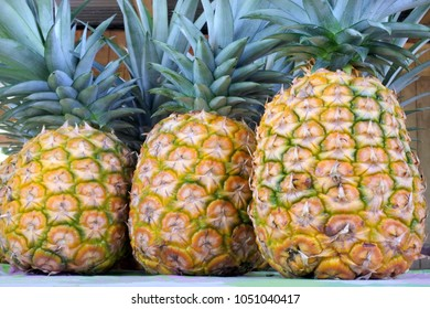 Pineapple on display in Rarotonga market, Cook Islands. Pineapple can help  both male and female fertility.Food background and texture. Copy space