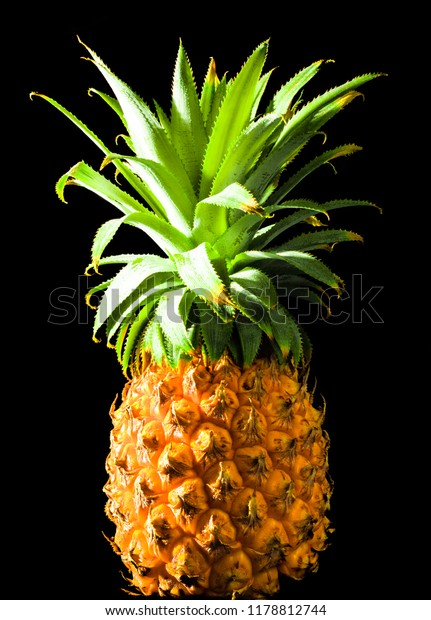 Pineapple on solid black background