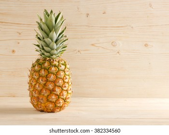 pineapple on a wooden background
