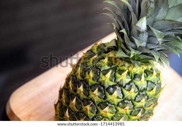 Pineapple on a wooden board