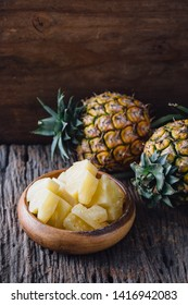pineapple on wooden table background