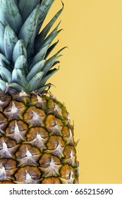 Pineapple on yellow background. Copy space