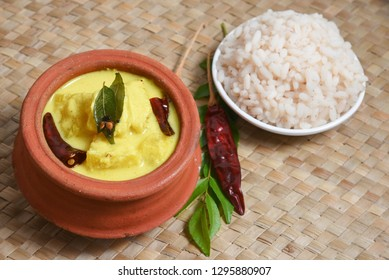 Pineapple Pachadi  or Moru curry with rice, a popular authentic Kerala recipe made of buttermilk and coconut. Hot and spicy curd curry a traditional South Indian cuisine for Onam, Vishu festival feast