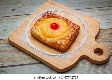 Pineapple pie is a sweet pastry containing butter, flour, egg, sugar, and pineapple.