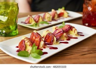 Pineapple ravioli with mascarpone cream, strawberries and mint