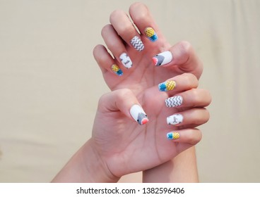 The pineapple and shark pattern in white nails on green natural background.