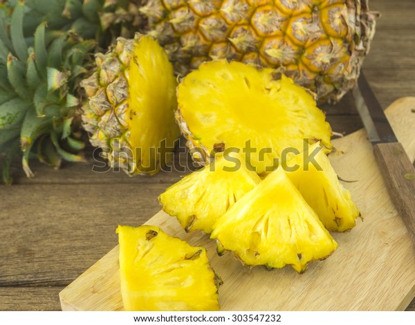 pineapple and pineapple slice on wood table. for health.