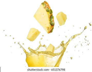 pineapple slice and pieces falling into yellow juice