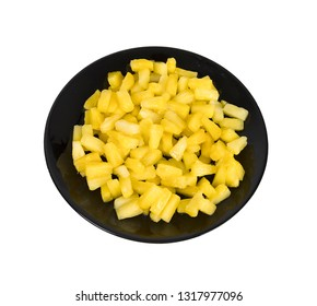 pineapple slices on a plate on a white background