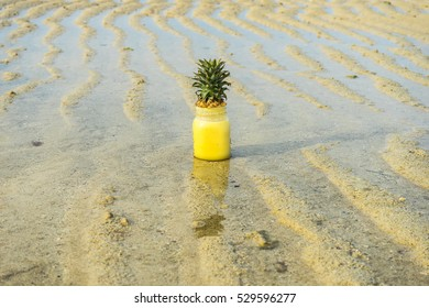 Pineapple smoothie, on a grass pineapple, pineapple smoothie, tasty, sweet, healthy nutrition, detox, pineapple smoothie in the sea and on sand.