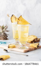 Pineapple spritzers against a light background ready for drinking.