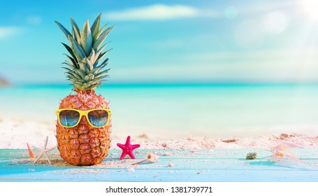 Pineapple With Sunglasses In The Beach