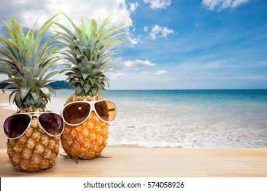 Pineapple sunglasses on beach backgroundconcept summer stock photo pineapple with sunglasses on beach backgroundconcept summer background voltagebd Images