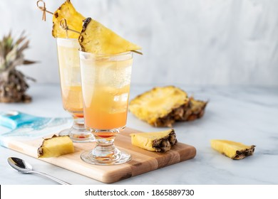 Pineapple Sunrise Mimosas ready for drinking with copy space to the right. - Shutterstock ID 1865889730