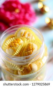 Pineapple tart inside jar. Prosperity cookies for Chinese New Year