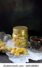 Pineapple tarts or nanas tart refers to small, bite-size pastries filled with or topped with pineapple jam found in different parts of Asia.  Selective focus