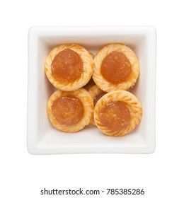 Pineapple tarts in a square bowl isolated on white background