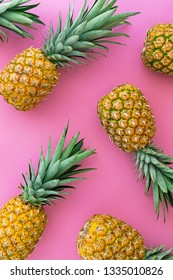 Pineapple tropical fruit on pink pastel background, summer concept, flat lay