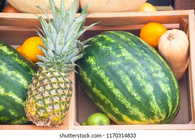 pineapple, watermelon and melon in boxes