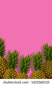 Pineapples on pink background table
