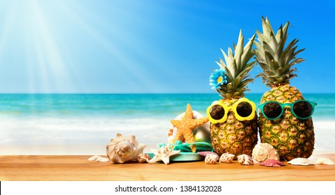Pineapples with starfish on the tropical beach