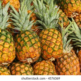 Pineapples together at the grocery store.