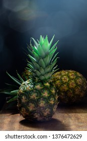 pinepple with 2 pineapples in background