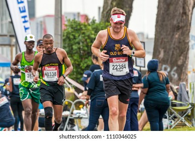 PINETOWN, DURBAN, SOUTH AFRICA - JUNE 10, 2018: Midday many spectators and unknown runners competing in the Comrades marathon between Pietermaritzburg and Durban in South Africa