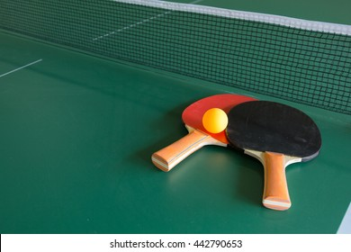 Ping pong ball with paddle on  table tennis