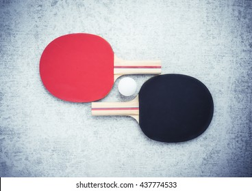 Ping pong or table tennis paddles and ball.