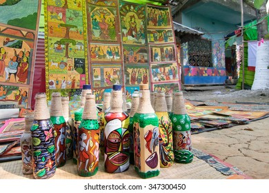 PINGLA, WEST BENGAL , INDIA - NOVEMBER 16TH 2015 : Colourful handicrafts are being prepared for sale in Pingla village. Handicrafts are popular rural Industry in West Bengal.