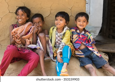 PINGLA, WEST BENGAL , INDIA - NOVEMBER 16TH 2014 : Unidentified Indian children smikling and laughing at Pingla village, West Bengal, India.