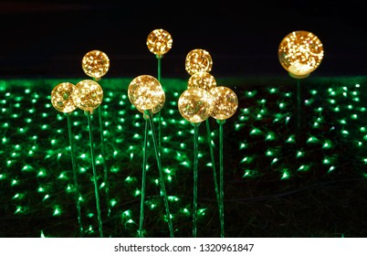 """Pingtung County,Taiwan - Feb 17th : The """"2019 Taiwan Lantern Festival"""" in Donggang Village in the Dapeng Bay . yellow round light and green LED light"""