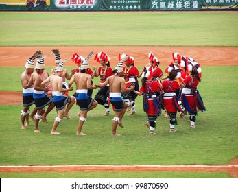 PINGTUNG, TAIWAN, APRIL 8: Aboriginal dancers perform before a Pro Baseball League game between the President Lions and the Lamigo Monkeys. The Lions won 2:0 on April 8, 2012 in Pingtung.