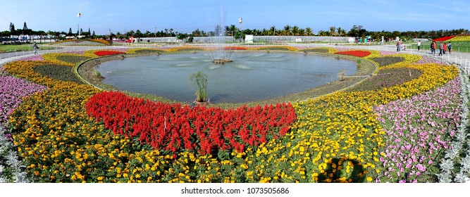 PINGTUNG, TAIWAN -- FEBRUARY 14, 2018: A large fountain surrounded by colorful flower beds greets visitors at the Pingtung Tropical Agricultural Fair.