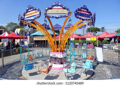 PINGTUNG, TAIWAN -- FEBRUARY 14, 2018: A traditional old style merry-go-round provides entertainment for children at the Pingtung Tropical Agricultural Fair.