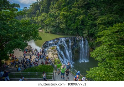 Pingxi, Taiwan - May 6, 2018: famous Taiwan travel destination, Shifen Waterfall with tourist, here is the biggest waterfall in Taiwan, 40 metre tall, is called to Taiwan's Niagara Falls. Pingxi Distr