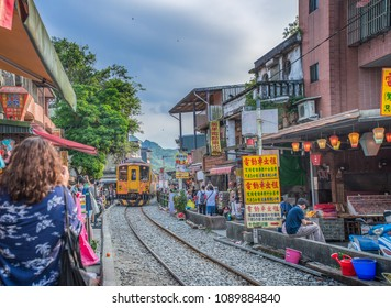 Pingxi, Taiwan - May 6, 2018: tourists are waiting for Local train comes at Shifen old street, here is the home of Taiwan sky Lantern.