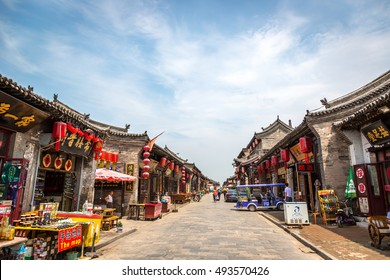Pingyao, China - July 12th. 2016 - Tourist and locals in the narrow streets of Pingyao ancient city in China, Asia.