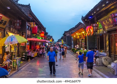 Pingyao, China - July 12th. 2016 - Tourists and local people in the ancient city of Pingyao in central China, Asia.