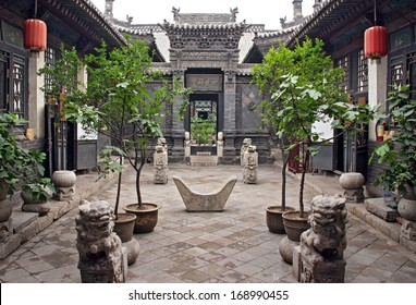 Pingyao, China - July 26, 2009: Ornamental courtyard of a historical house in Pingyao on July 26, 2009. Pingyao ancient town is one of the greatest attractions of Shanxi province.