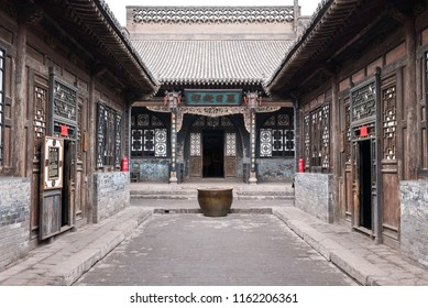 PINGYAO, CHINA - MARCH 24, 2017 - The traditional Chinese courtyard of a historical house in Pingyao. Pingyao is the best-preserved ancient walled town in China.