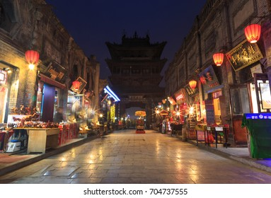 PINGYAO, CHINA - NOVEMBER 18, 2017: Night view of ancient City of Ping Yao (UNESCO World Heritage site). A famous historic site in Pingyao, Shanxi, China.