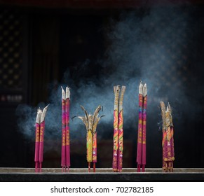 PINGYAO, CHINA - NOVEMBER 19, 2017: Traditional chinese smoke candles burning at a temple in ancient City of Ping Yao (UNESCO World Heritage site). A famous historic site in Pingyao, Shanxi, China.