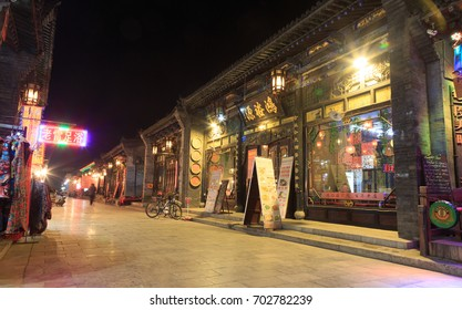PINGYAO, CHINA - NOVEMBER 19, 2017: Night view of ancient City of Ping Yao (UNESCO World Heritage site). A famous historic site in Pingyao, Shanxi, China.