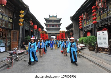 PINGYAO - MAY 2: People in traditional costume announce Zhang Yimou's new folk show 'Impressions Pingyao' on May 2, 2012 in Pingyao, China. Zhang Yimou is China's most famous film director.