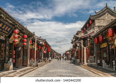 Pingyao, Shanxi, China - June 2018: red lantern and shops in the main street of Pingyao ancient town